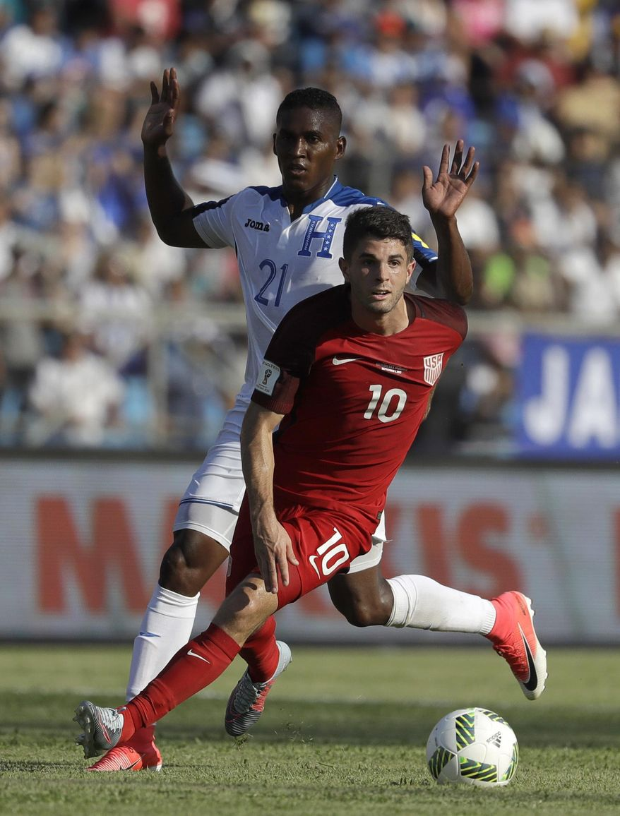 United States' Christian Pulisic controls the ball past Honduras' Brayan Beckeles during a 2018 World Cup qualifying soccer match in San Pedro Sula, Honduras, Tuesday, Sept. 5, 2017. (AP Photo/Rebecca Blackwell)