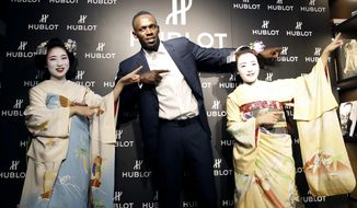Usain Bolt of Jamaica gestures with maiko, or an apprentice geisha, during a promotional event in Kyoto, western Japan, Tuesday, Sept. 5, 2017. Bolt says he has no regrets about retiring and is confident his world records will stand for at least another 15 years. The only sprinter to capture the 100 and 200 titles at three consecutive Olympics, Bolt retired last month after the world championships in London. He leaves the sport holding the world record of 9.58 seconds in the 100 meters and 19.19 in the 200. (Yosuke Mizuno/Kyodo News via AP)