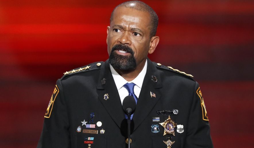 FILE - In this July 18, 2016, file photo, former Milwaukee County, Wis. Sheriff David Clarke speaks at the Republican National Convention in Cleveland. Clarke is joining a political action committee that supports President Donald Trump. Clarke announced in an email Tuesday, Sept. 5, 2017, that he will serve as spokesman and senior adviser for America First Action. (AP Photo/J. Scott Applewhite, File)