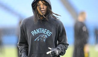 FILE - This Aug. 31, 2017 file photo shows Carolina Panthers' Kelvin Benjamin warming up before an NFL preseason football game against the Pittsburgh Steelers in Charlotte, N.C.  Benjamin said he is dedicating the season to his mother Christine, who passed away in July. (AP Photo/Mike McCarn)