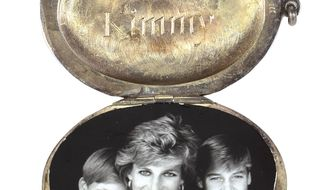"This August 2017 photo provided by RR Auction shows a locket containing a photograph of Princess Diana and her sons Prince Harry, left, and Prince William, "" that is among dozens of items with a direct connection to the princess that are being sold at auction by Boston-based RR Auction.  Bidding ends Sept. 13.  (Sarina Carlo/RR Auction via AP)"