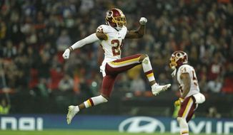 FILE - In this Oct. 30, 2016, file photo, Washington Redskins cornerback Josh Norman (24) celebrates a turnover during an NFL Football game against the Cincinnati Bengals, in London, England. Coming off a season in which he was the most penalized player in the NFL and didn't make the Pro Bowl, Josh Norman is licking his chops thinking about what's next. A different scheme under new defensive coordinator Greg Manusky has Norman and everyone else around the Washington Redskins thinking this is Norman's year to shine. (AP Photo/Matt Dunham, File) **FILE**