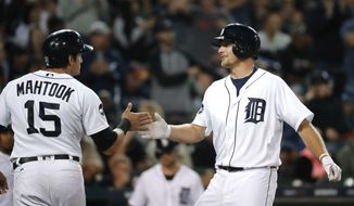 Detroit Tigers' John Hicks, right, celebrates his two-run home run with Mikie Mahtook (15) during the fourth inning against the Kansas City Royals in a baseball game in Detroit, Tuesday, Sept. 5, 2017. (AP Photo/Paul Sancya)