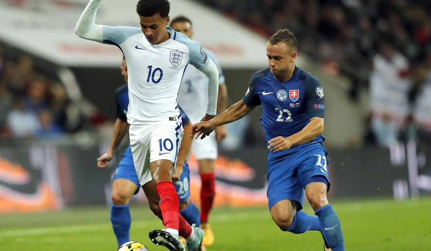 England's Dele Alli, left, and Slovakia's Stanislav Lobotka, right, challenge for the ball during the World Cup Group F qualifying soccer match between England and Slovakia at the Wembley stadium in London, Great Britain, Monday, Sept. 4, 2017. (AP Photo/Frank Augstein)