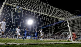 Italy's Ciro Immobile, right, scores during the World Cup Group G qualifying soccer match between Italy and Israel at the Mapei Stadium in Reggio Emilia, Italy, Tuesday, Sept. 5, 2017. Italy won 1-0. (AP Photo/Luca Bruno)