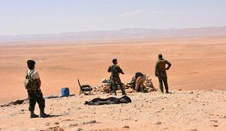 This photo released on Saturday, Sept 2, 2017, by the Syrian official news agency SANA, shows Syrian troops and pro-government gunmen standing guard at one of the frontline hills where they are fighting Islamic State militants in the eastern city of Deir el-Zour, Syria. Syrian opposition activists and state media say government forces are close to breaking a nearly three-year siege imposed by the Islamic State group on parts of the provincial capital of the oil-rich province of the same name. (SANA via AP)