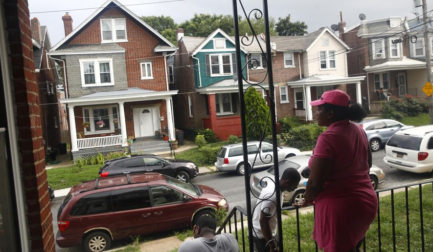"ADVANCE FOR USE FRIDAY, SEPT. 8, 2017 AND THEREAFTER-In this July 27, 2017 photo, Maria Williams stands on her front porch in Wilmington, Del., the day after her teenage son and daughter were shot and wounded while standing on the same porch. As she took cover inside and heard her kids' screams, ""All I could think of was, 'I'm not losing another child,'"" Williams recalled. Her 18-year-old stepson had been gunned down two years before, another victim of Wilmington's plague of teens shooting teens. His shooter was 17. (AP Photo/Patrick Semansky)"