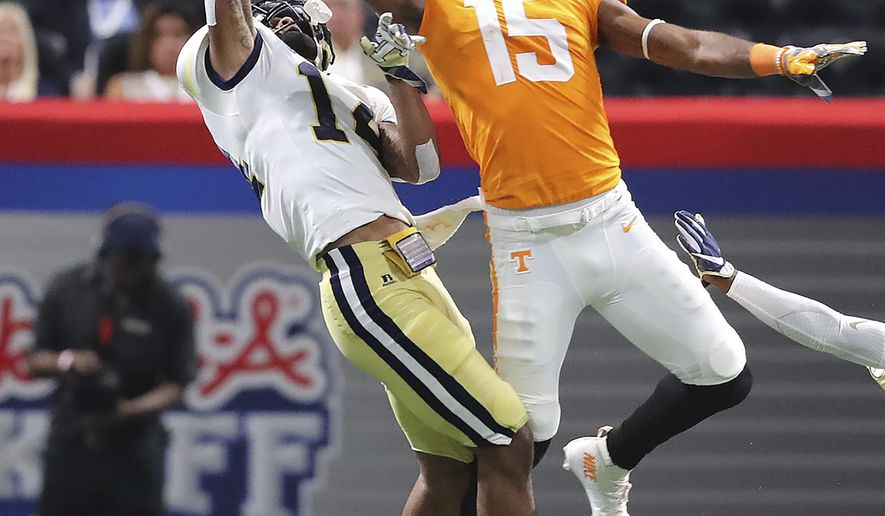 Georgia Tech defensive back Corey Griffin breaks up a pass to Tennessee wide receiver Jauan Jennings during the second quarter in a NCAA college football game on Monday, Sept. 4, 2017, in Atlanta. (Curtis Compton/Atlanta Journal-Constitution via AP)