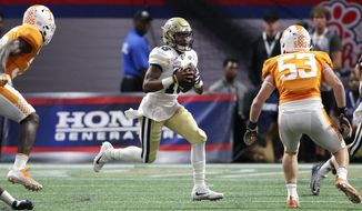 Georgia Tech quarterback TaQuon Marshall (16) runs the ball against the Tennessee in the first half of an NCAA college football game, Monday, Sept. 4, 2017, in Atlanta. (AP Photo/John Bazemore)