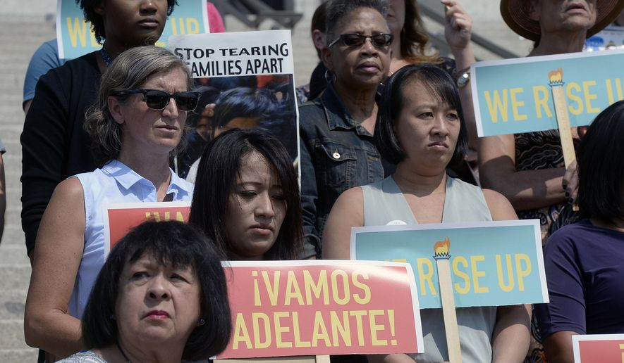 """A diverse group gathers on the steps of the Utah state capitol in Salt Lake City, Tuesday, Sept. 5, 2017, with Comunidades Unidas (Communities United), an organization that says that the Trump administration's plans to end the DACA program is bad for Utah's families and economy. Individuals including """"Dreamers"""" spoke out for Congress to come up with alternative legislation. (Al Hartmann/The Salt Lake Tribune via AP) **FILE**"""