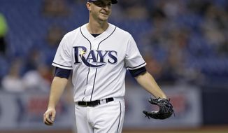 Tampa Bay Rays starting pitcher Jake Odorizzi smiles at Minnesota Twins' Joe Mauer after Mauer broke up Odorizzi's no-hit bid with a single during the seventh inning of a baseball game Tuesday, Sept. 5, 2017, in St. Petersburg, Fla. (AP Photo/Chris O'Meara)