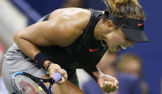 Madison Keys, of the United States, reacts as she won points against Elina Svitolina, of Ukraine, in a fourth-round match at the U.S. Open tennis tournament in New York, Monday, Sept. 4, 2017. (AP Photo/Kathy Willens)