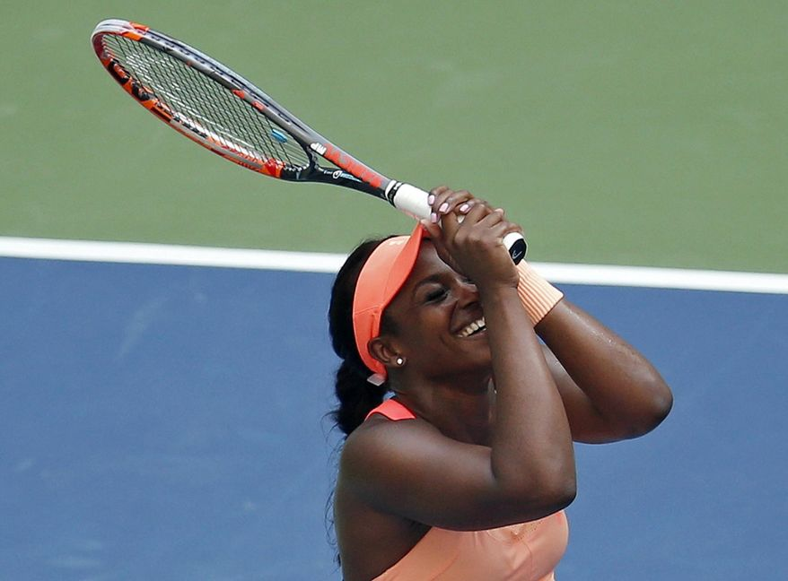 Sloane Stephens, of the United States, reacts after beating Anastasija Sevastova, of Latvia, during the quarterfinals of the U.S. Open tennis tournament, Tuesday, Sept. 5, 2017, in New York. (AP Photo/Jason Decrow)