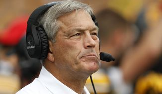 Iowa head coach Kirk Ferentz watches from the sidelines during the first half of an NCAA college football game against Wyoming, Saturday, Sept. 2, 2017, in Iowa City, Iowa. Iowa won 24-3. (AP Photo/Charlie Neibergall)