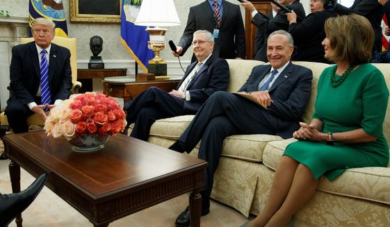 President Trump meets with Senate Majority Leader Mitch McConnell, Senate Minority Leader Charles E. Schumer, House Minority Leader Nancy Pelosi in the Oval Office on Wednesday. They discussed DACA. (Associated Press)