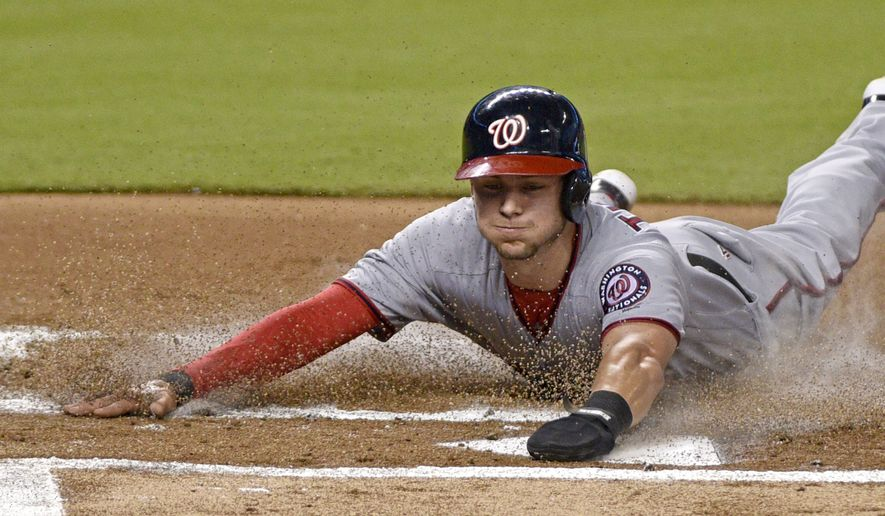 Washington Nationals' Trea Tunner slides into home plate during the first inning of a baseball game against the Washington Nationals, Wednesday, Sept. 6, 2017, in Miami. (AP Photo/Gaston De Cardenas)