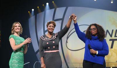 Oprah Winfrey salutes then-Capt. Jaspen Boothe, U.S. Army Reserves.