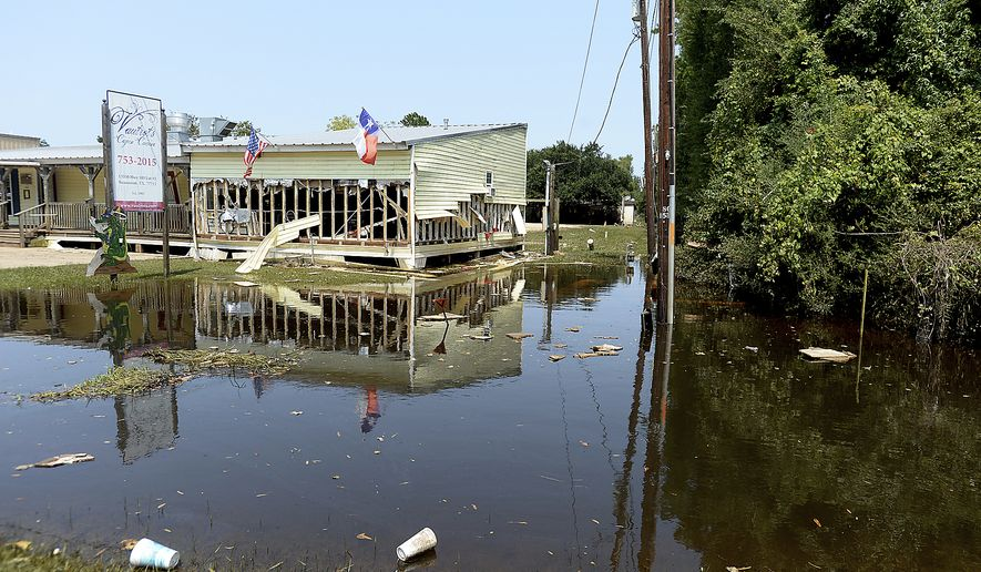 Vautrot's Cajun Cuisine shows the severe damage caused inside and out following heavy flooding, Wednesday, Sept. 6, 2017 in Bevil Oaks, Texas. (Kim Brent/The Beaumont Enterprise via AP)
