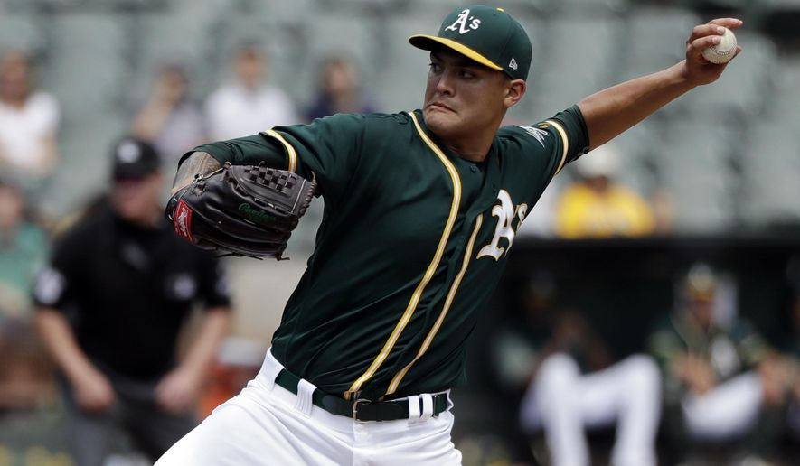 Oakland Athletics starting pitcher Sean Manaea throws to the Los Angeles Angels during the third inning of a baseball game Wednesday, Sept. 6, 2017, in Oakland, Calif. (AP Photo/Marcio Jose Sanchez)
