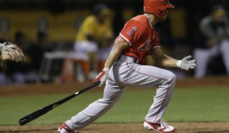 Los Angeles Angels' Ben Revere swings for an RBI single off Oakland Athletics' Blake Treinen in the tenth inning of a baseball game Tuesday, Sept. 5, 2017, in Oakland, Calif. (AP Photo/Ben Margot)
