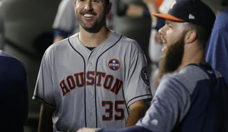Houston Astros starting pitcher Justin Verlander (35) smiles in the dugout with teammates after finishing the sixth inning of a baseball game against the Seattle Mariners, Tuesday, Sept. 5, 2017, in Seattle. (AP Photo/Ted S. Warren)