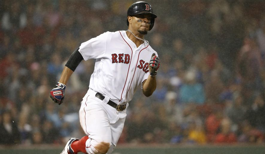 Boston Red Sox's Xander Bogaerts runs on a triple against the Toronto Blue Jays during the fourth inning of a baseball game at Fenway Park in Boston, Wednesday, Sept. 6, 2017. (AP Photo/Winslow Townson)