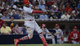 St. Louis Cardinals' Jose Martinez swings on a home run during the seventh inning of a baseball game against the San Diego Padres on Tuesday, Sept. 5, 2017, in San Diego. (AP Photo/Orlando Ramirez)
