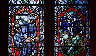 "A detail of stained glass windows depicting two iconic Confederate generals that are being removed is seen at the Washington National Cathedral in Washington, Wednesday, Sept. 6, 2017. Cathedral authorities announced Wednesday that windows depicting generals Robert E. Lee and Thomas ""Stonewall"" Jackson will be removed and stored pending a decision about their future. (AP Photo/Carolyn Kaster)"