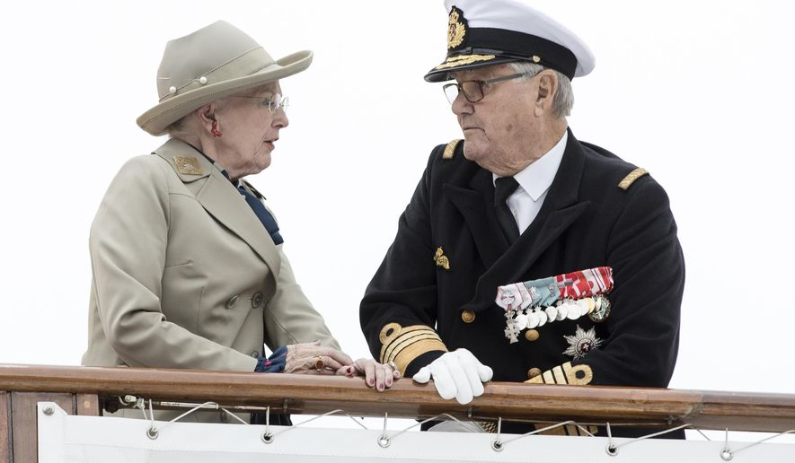 FILE - In this June.23 2017 file photo Denmark's Queen Margrethe and her husband Prince Henrik arrive by boat at Aarhus Harbour, Jutland.  The Denmark royal household says Wednesday Sept. 6, 2017, that Prince Henrik is suffering from dementia, and has undergone medical examinations at Copenhagen's university hospital over recent months. (Mikkel Berg Pedersen/AP via ritzau, file)
