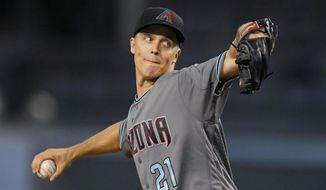 Arizona Diamondbacks starting pitcher Zack Greinke winds up during the first inning of a baseball game against the Los Angeles Dodgers, Tuesday, Sept. 5, 2017, in Los Angeles. (AP Photo/Mark J. Terrill)
