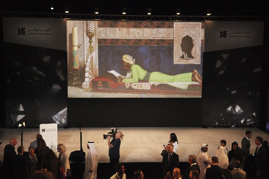 Journalists gather after an announcement about the opening of the Louvre Abu Dhabi in Abu Dhabi, United Arab Emirates, Wednesday, Sept. 6, 2017. Officials on Wednesday announced that the Louvre Abu Dhabi, a Mideast outpost of the famed French museum, will open Nov. 11. (AP Photo/Jon Gambrell)