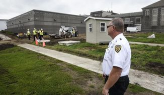 In this Friday, Aug. 25, 2017 photo, security Captain Dean Weis talks about a new expansion project underway during a tour of the Minnesota Correctional Facility in St. Cloud, Minn. The prison will soon undergo the second phase of upgrades with $37 million in bonding from the state. Phase one, which included a new health center, is nearly complete. Phase two updates laundry, warehouse and intake spaces. (Dave Schwarz/St. Cloud Times via AP)