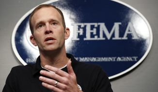 FILE - In this Aug. 31, 2017, file photo, Federal Emergency Management Agency (FEMA) Administrator Brock Long speaks during a news conference in Washington. At FEMA headquarters, top officials responsible for responding to large-scale public emergencies meet regularly to conduct drills and update plans covering numerous worst-case scenarios. That includes what to do if two massive hurricanes strike the U.S. mainland within days, 1,000 miles apart. Those plans are now being put into action as Hurricane Irma bears down on the Florida coast less than a week after Hurricane Harvey flooded much of Houston. (AP Photo/Jacquelyn Martin, File)