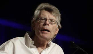 """In this June 1, 2017, photo, author Stephen King speaks at Book Expo America in New York. King discussed in an interview with The Associated Press how he views Hollywood adaptations of his writings, including the upcoming film """"It,"""" and how even as the leading creator of horror fiction, he still has the ability to write things that scare him. (AP Photo/Mark Lennihan)"""