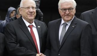 German President Frank-Walter Steinmeier, right, welcomes Israeli President Reuven Rivlin for the opening ceremony at the new memorial commemorating the eleven Israeli athletes, who were killed in a terrorist attack during the 1972 Olympic Games in Munich, Germany, Wednesday, Sept. 6, 2017. (AP Photo/Matthias Schrader)