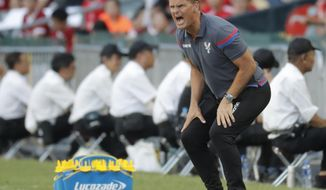 FILE- In this Saturday, July 22, 2017 file photo, Frank de Boer, manager of Crystal Palace FC, shouts during the third place playoff match against West Bromwich Albion FC at the Premier League Asia Trophy soccer tournament in Hong Kong. Frank de Boer has lost his first three Premier League games in charge of Crystal Palace and is already under pressure.  (AP Photo/Kin Cheung, File)