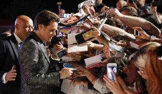 Actor Jim Carrey signs autographs at the premiere of the film 'Jim and Andy: The Great Beyond' at the 74th edition of the Venice Film Festival in Venice, Italy, Tuesday, Sept. 5, 2017. (AP Photo/Domenico Stinellis)