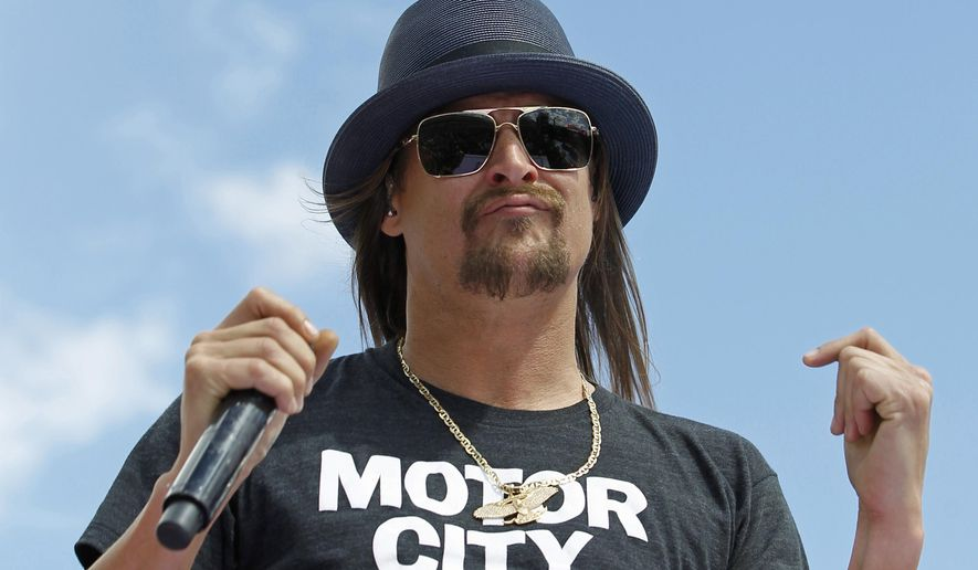 """In this Feb. 22, 2015, file photo, Kid Rock performs before the Daytona 500 NASCAR Sprint Cup series auto race at Daytona International Speedway in Daytona Beach, Fla. A civil rights organization said Wednesday, Sept. 6, 2017, they are demanding the cancellation of concerts by Kid Rock at a new sports arena in Detroit, saying his criticism of NFL quarterback Colin Kaepernick was a """"dog whistle"""" to white supremacist groups. (AP Photo/Terry Renna, File)"""