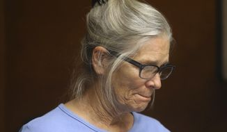 Leslie Van Houten reacts after hearing she is eligible for parole during a hearing on Wednesday, Sept. 6, 2017 at the California Institution for Women in Corona, Calif. Van Houten, the youngest of Charles Manson's murderous followers, was granted parole by a California board Wednesday. (Stan Lim/Los Angeles Daily News via AP, Pool)