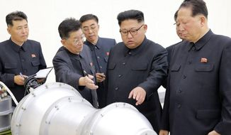 This undated file photo distributed on Sunday, Sept. 3, 2017, by the North Korean government, shows North Korean leader Kim Jong-un, second from right, at an undisclosed location. (Korean Central News Agency/Korea News Service via AP)
