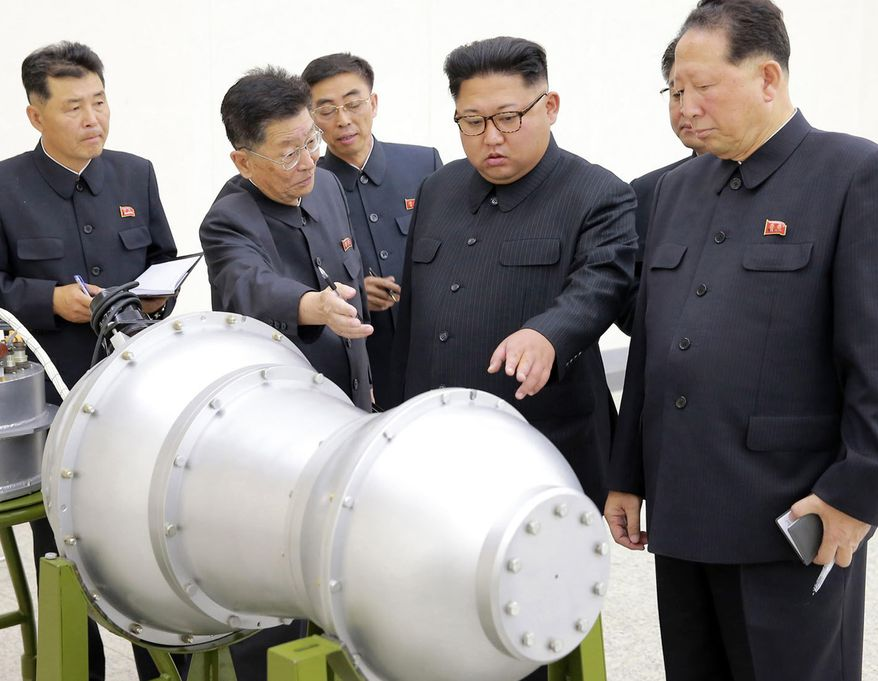 This undated file photo distributed on Sunday, Sept. 3, 2017, by the North Korean government, shows North Korean leader Kim Jong-un, second from right, at an undisclosed location. (Korean Central News Agency/Korea News Service via AP) ** FILE **
