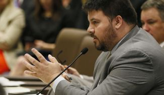 FILE - In this Feb. 22, 2017, file photo, state Sen. Ralph Shortey, R-Oklahoma City, speaks during a Senate committee meeting on a Real ID bill in Oklahoma City. Shortey, who faces state child prostitution charges for allegedly hiring a 17-year-old boy for sex, has been indicted by a federal grand jury on child pornography and child sex trafficking charges. The four-count federal indictment that was unsealed Wednesday, Sept. 6, 2017. Shortey resigned in March after he was arrested on state charges. He faces up to life in prison if convicted on the federal charges. (AP Photo/Sue Ogrocki, File)