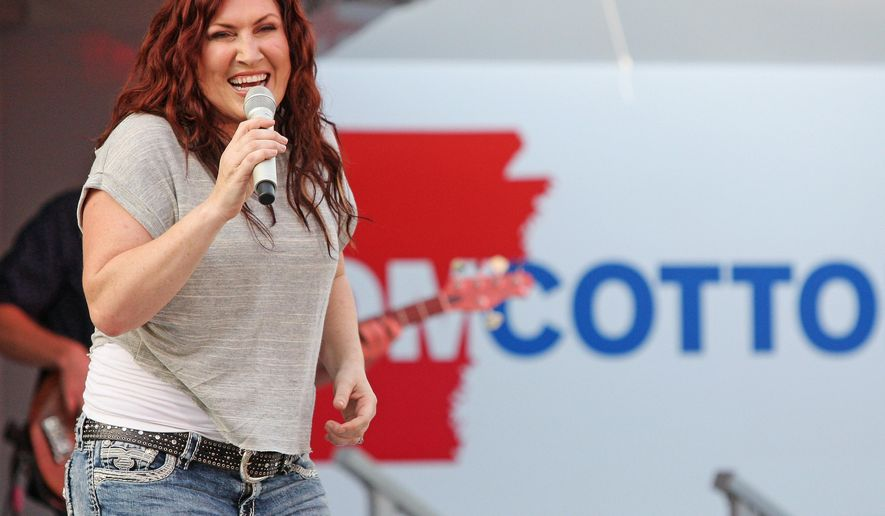 """In this Friday, June 6, 2014, photo, country music singer Jo Dee Messina sings onstage in El Dorado, Ark., during a fundraiser for Rep. Tom Cotton, R-Ark. The country singer, who had hits with songs like """"I'm Alright"""" and """"Bye Bye,"""" announced Wednesday, Sept. 6, 2017, that she has cancer and will be postponing her 2017, show dates after Oct. 7, 2017. (Michael Orrell/The El Dorado News-Times via AP, File)"""