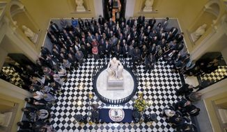 Mourners crowd around the casket of former Del. Lacey Putney as it lies in state in the Capitol Rotunda, Wednesday, Sept. 6, 2017, in Richmond, Va. Putney, who died last month at the age of 89, retired in 2013 after serving 52 years in the state legislature representing Bedford.  (Bob Brown/Richmond Times-Dispatch via AP)