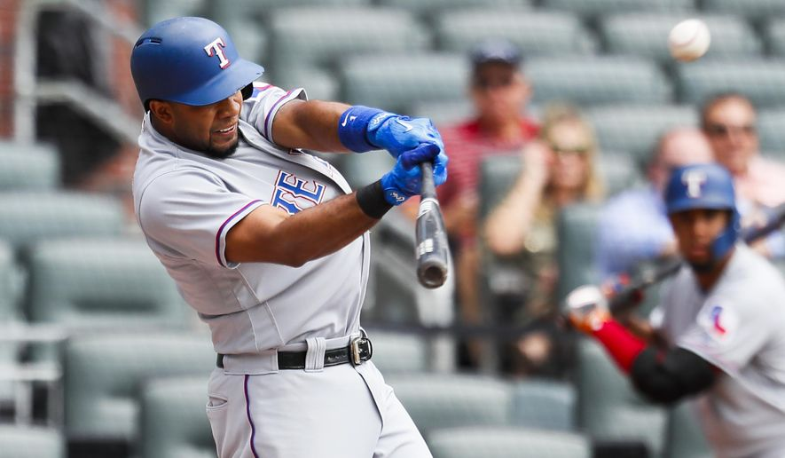 Texas Rangers' Elvis Andrus (1) hits a solo home run in the first inning of the first game of a baseball doubleheader against the Atlanta Braves, Wednesday, Sep. 6, 2017, in Atlanta. (AP Photo/Todd Kirkland)