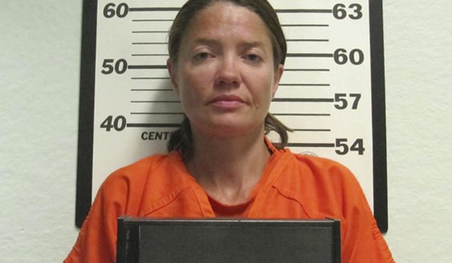 This Wednesday, Sept. 6, 2017 booking photo released by the Iowa County Sheriff's Department shows Mariana Lesnic, in Marengo, Iowa, who is charged with first-degree murder in the shooting of a truck driver found dead in his cab at a rest stop early Wednesday, along Interstate 80 near Victor, Iowa. (Iowa County Sheriff's Department via AP)