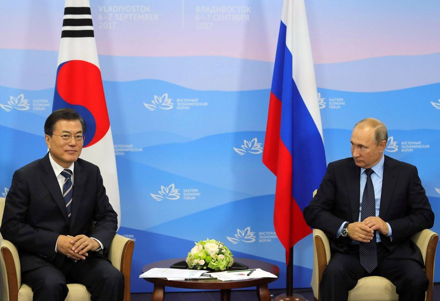 Russian President Vladimir Putin, right, look at South Korean President Moon Jae-in during their meeting at the Eastern Economic Forum in Vladivostok, Russia, Wednesday, Sept. 6, 2017. (Mikhail Klimentyev, Sputnik, Kremlin Pool Photo via AP)