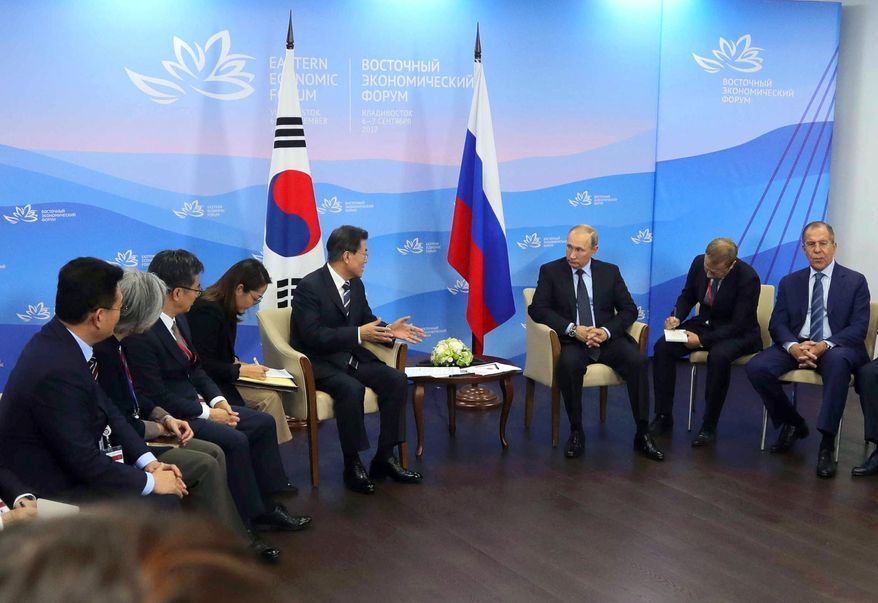 Russian President Vladimir Putin, third from right, listens to South Korean President Moon Jae-in, fifth from left, during their meeting at the Eastern Economic Forum in Vladivostok, Russia, Wednesday, Sept. 6, 2017. (Mikhail Klimentyev, Sputnik, Kremlin Pool Photo via AP)