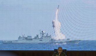 Col. Gen. Sergei Rudskoi of the Russian General Staff attends a briefing in the Russian Defense Ministry in Moscow, Russia, Wednesday, Sept. 6, 2017, backdropped by a screen showing a Russian navy's Admiral Essen frigate launching a cruise missile at the Islamic state in Syria. The commander of the Russian forces in Syria Sergei Surovikin says Russian jets have carried out more than 2,600 airstrikes in the past two weeks to support the government's efforts to drive Islamic State militants from an eastern city. (AP Photo/Pavel Golovkin)