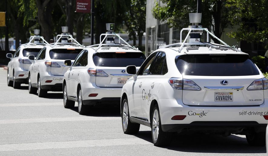 FILE - This May 13, 2014, file photo shows a row of Google self-driving Lexus cars at a Google event outside the Computer History Museum in Mountain View, Calif. The House voted Wednesday, Sept. 6, 2017, to speed the introduction of self-driving cars by giving the federal government authority to exempt automakers from safety standards not applicable to the technology, and to permit deployment of up to 100,000 of the vehicles annually over the next several years. (AP Photo/Eric Risberg, File)